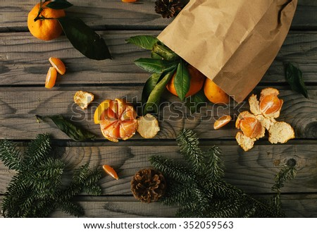 Tangerine placer in to paper packet on the table - stock photo