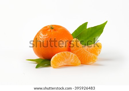 tangerine with separated segments on white background - stock photo