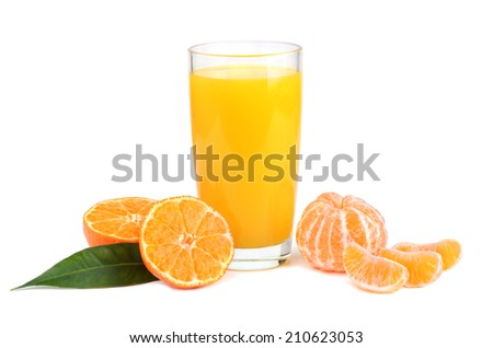 Tangerines and juice in glass on white background - stock photo