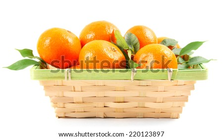 Tangerines in a basket on a white background. - stock photo