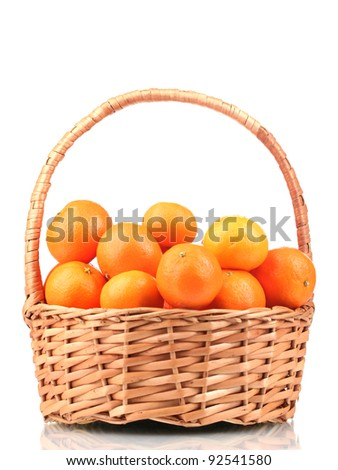 tangerines in a beautiful basket isolated on white - stock photo