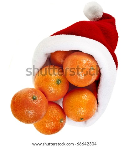 tangerines  in a christmas hat  isolated over a white - stock photo