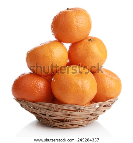 Tangerines in basket isolated on white - stock photo