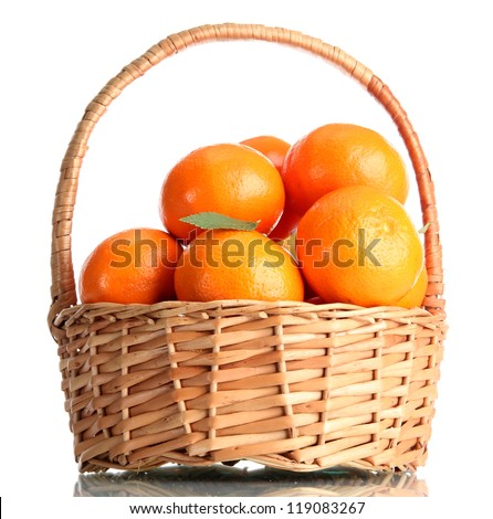 tangerines with leaves in a beautiful basket isolated on white - stock photo