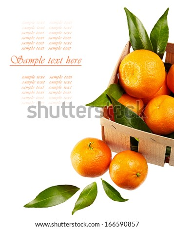 tangerines with leaves in basket isolated on white background - stock photo
