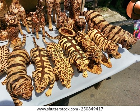 TANGKUBAN PERAHU, BANDUNG, WEST JAVA, INDONESIA - SEPTEMBER 15, 2014: Wooden animal toy miniatures on sale in Tangkuban Perahu, Indonesia. These wooden toys are made from special batik wood. - stock photo