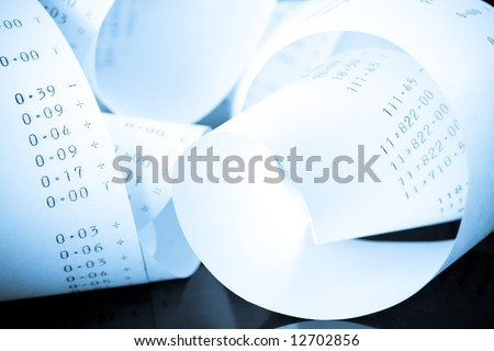 Tangled Coil of a Tape from an Adding Machine in Blue Tone - stock photo