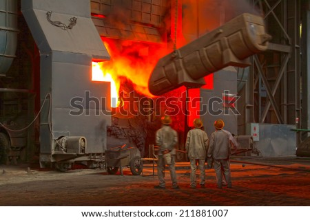 TANGSHAN - JUNE 20: steel mills converter workers tense work, on June 20, 2014, Tangshan city, Hebei Province, China  - stock photo