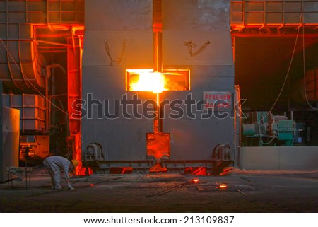 TANGSHAN - JUNE 20: steel mills converter workers tense work, on June 20, 2014, Tangshan city, Hebei Province, China  - stock photo