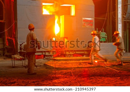 TANGSHAN - JUNE 18: Technical staff check the quality of molten steel, in a iron and steel co., on June 18, 2014, Tangshan city, Hebei Province, China  - stock photo