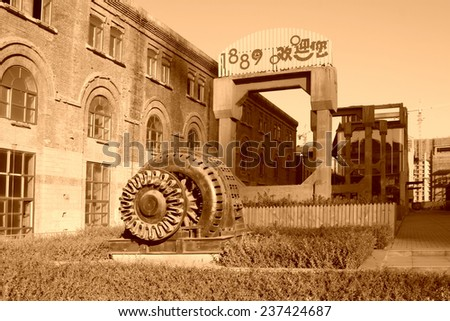 TANGSHAN - NOVEMBER 4: The abandoned large asynchronous motor in the Qixin cement plant on november 4, 2013, tangshan city, hebei province, China.   - stock photo