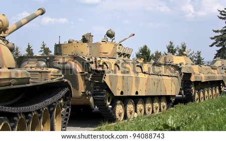 tank column on the march in the streets - stock photo