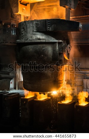 Tank pours the liquid steel in the forms - stock photo