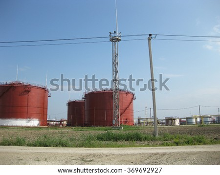 Tank the vertical steel. Capacities for storage of oil, gasoline, kerosene, the diesel and other liquids. - stock photo