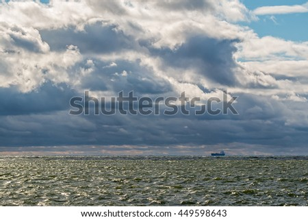 Tanker at anchorage at stormy weather on the Baltic sea - stock photo