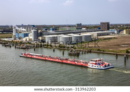 Tanker cargo vessel in sea port Rotterdam, Netherlands. - stock photo
