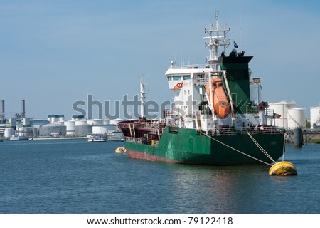 tanker moored at a yellow buoy in the rotterdam harbor - stock photo