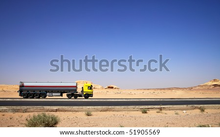 Tanker truck drive on highway at desert - stock photo