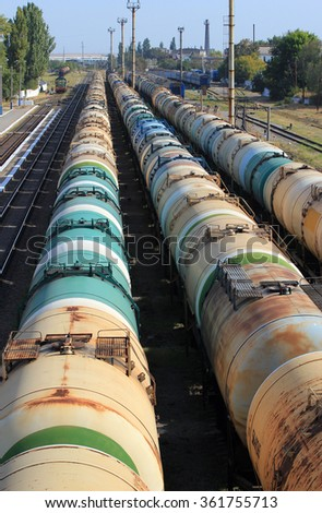Tanks with fuel on freight railway station - stock photo