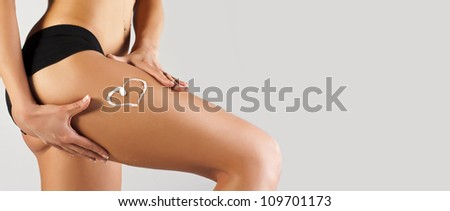 Tanned skinny woman in the studio - stock photo