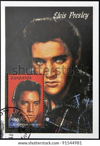 TANZANIA - CIRCA 1997: A stamp printed in Tanzania shows Elvis Presley, circa 1997 - stock photo