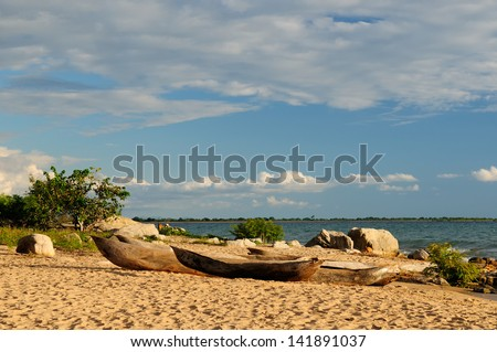 Tanzania, Malawi lake (Nyasa) is of the Africa third largest lake is an African Great Lake. The picture presents traditional dugout canoe or bwato  on the beautiful sand beach - stock photo