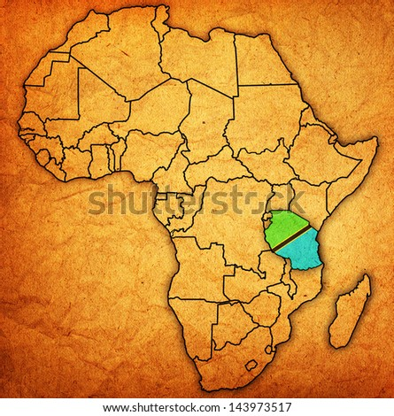 tanzania on actual vintage political map of africa with flags - stock photo
