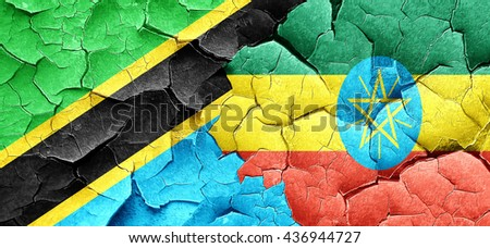 Tanzanian flag with Ethiopia flag on a grunge cracked wall - stock photo
