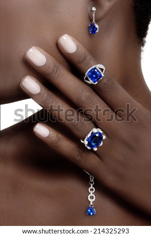 Tanzanite and Diamonds Designer Jewellery on the Skin of a Black Lady - stock photo
