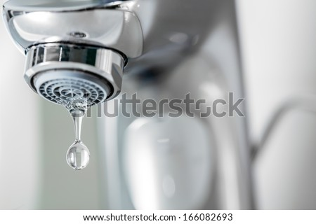 Tap closeup with dripping water-drop. Water leaking, saving concept. - stock photo