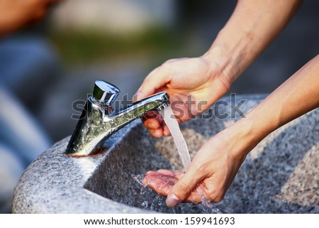 Tap outdoor washing hand - stock photo