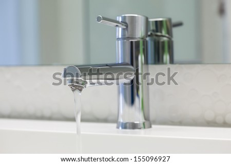 Tap water out / Water tap - stock photo
