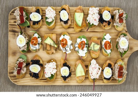 tapas of shrimp and cheese - stock photo