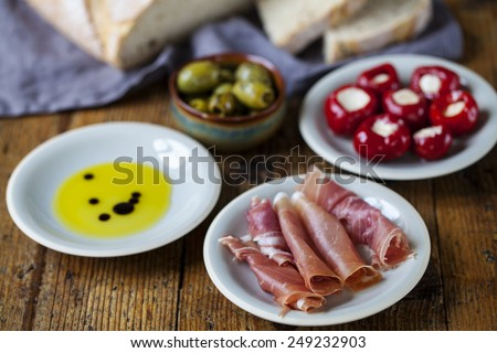 Tapas with ham,olives and peppers - stock photo
