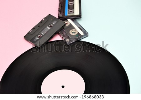 Tape cassette and vinyl record - stock photo