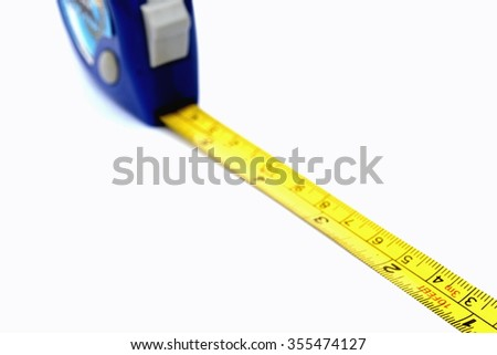 Tape measure isolated in white background - stock photo