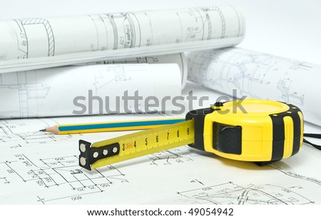 tape -measure on the drawing - stock photo