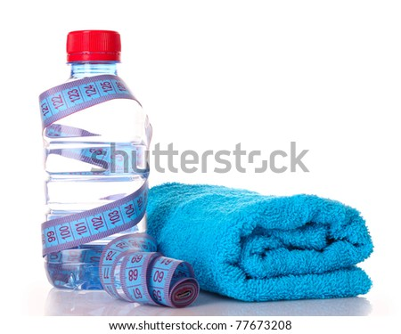 Tape measure, towels  and water bottle - stock photo