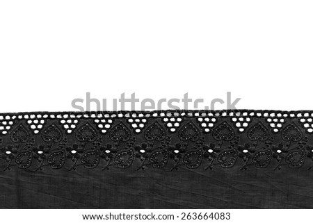 Tape of vintage black lace isolated over white - stock photo