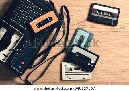 tape recorder with music cassettes, vintage - stock photo