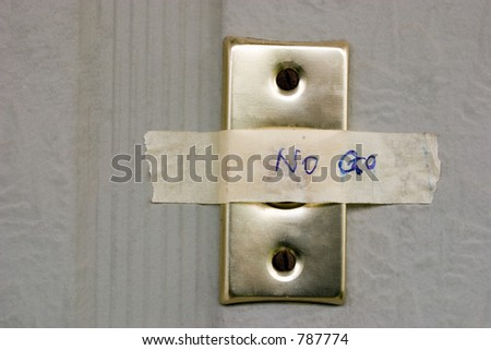 Taped over button - stock photo