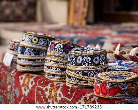 Taqiyah, traditional muslim hats sold on a local market in Icheri Sheher (Old Town) in the Center of Baku, Azerbaijan. Horizontal orientation. - stock photo