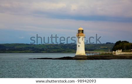 Tarbet lighthouse and the Shannon river estuary, Ireland. - stock photo