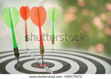 Target dart and target arrow with bokeh background. Abstract bokeh background and dart board. - stock photo