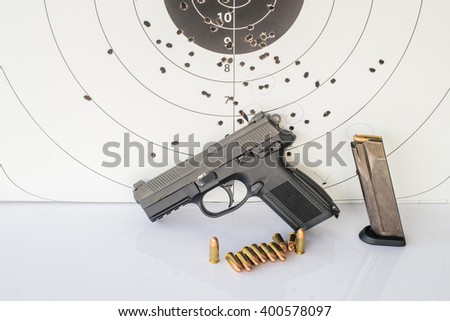 Target gun and ammunition on white background. - stock photo