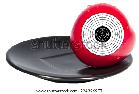 Target red tomato black plate isolated white background - stock photo