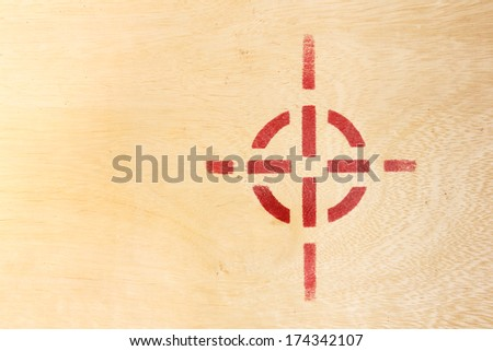 Target symbol on wood board - stock photo