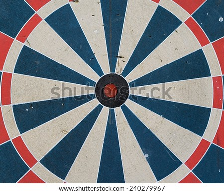 target with a misaligned red center - stock photo