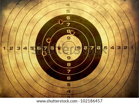 Target with bullet holes over grunge background - stock photo