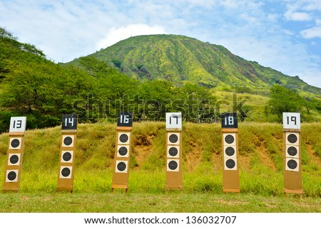 Targets for a shooting range with bulls-eye's are lined up in a row. - stock photo